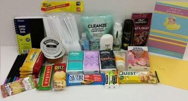 care package \ aHUS News \ Various items in a care package columnist Annie Dixon assembled for her mother, including small items like healthy snacks, deodorant, Kleenex, and applesauce, among others